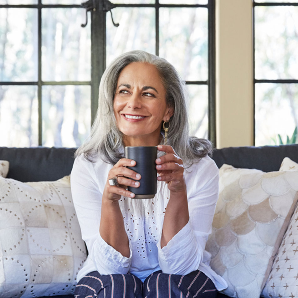 Smiling Woman Couch Coffee